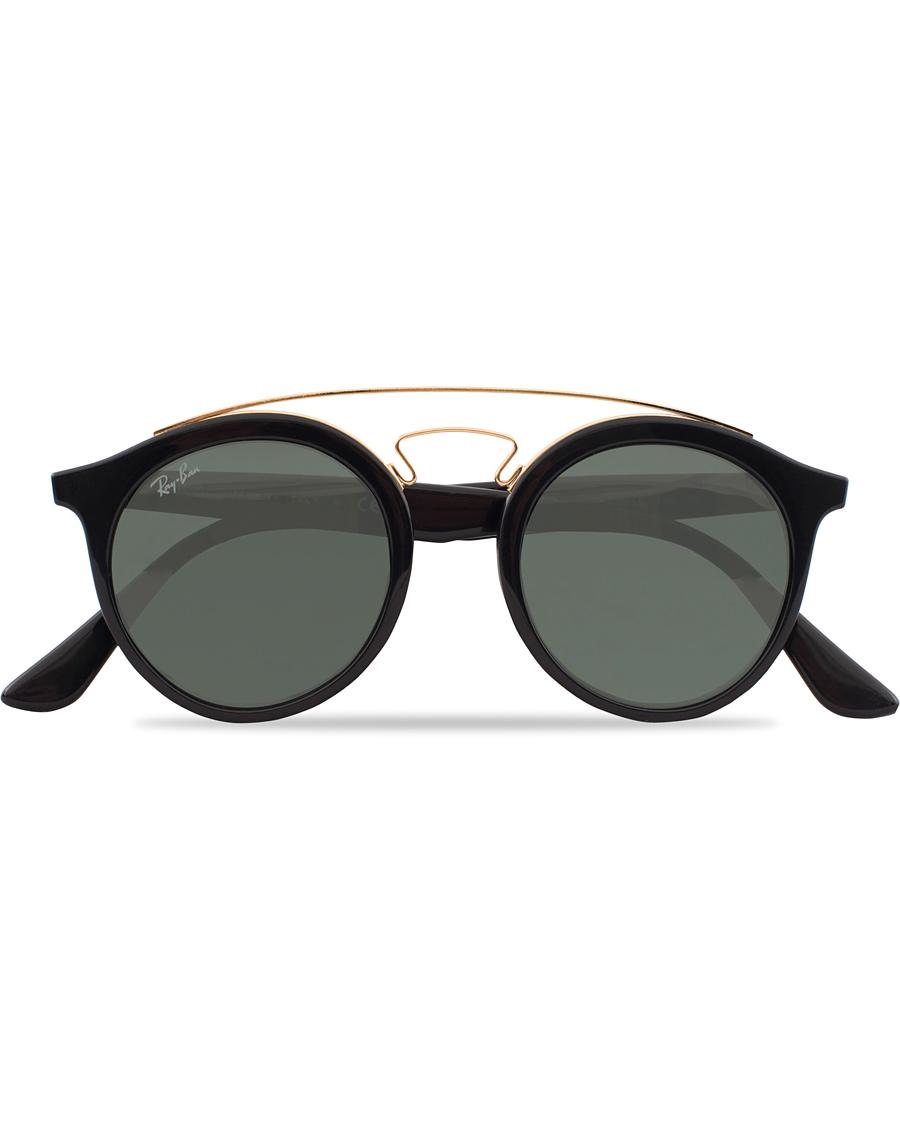 5f9c7b7b2b2c Ray-Ban RB4256 Round Sunglasses Black Dark Green hos CareOfCarl.